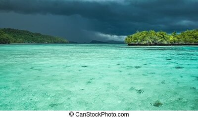 Beautiful blue lagoon with pure clear water shortly before thunderstorm begining, Gam Island, West Papua, Raja Ampat, Indonesia
