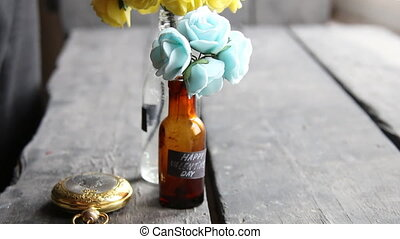Happy Valentines Day label and nice flowers in the bottles -...