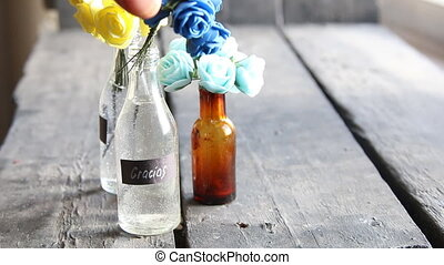 Gracias, thank you in Spanish, tag and flowers in a bottle -...