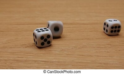 Dice rolling on the table. Close-up. - Dice rolling on the...