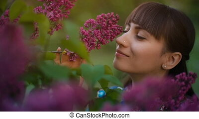 Woman smelling lilac - beautiful woman smelling lilac...