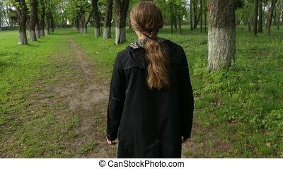 Woman walking forest