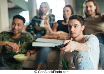 Blur image of a five friends sitting with pizza - Blur image...