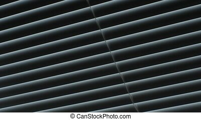 Closing and opening the blinds of the window.