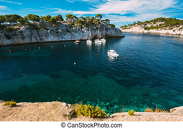 White Yachts boats in bay. Calanques in the azure coast of...
