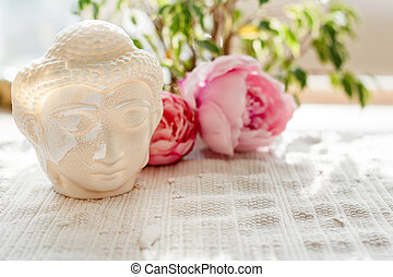 Buddha face. Buddha statue made of white marble with...