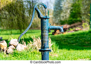 Old water pump from metal - The very Old water pump from...