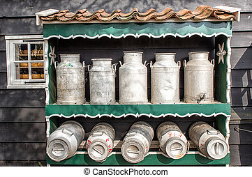 Traditional Dutch Milk Cans - Rack with classic milk cans on...