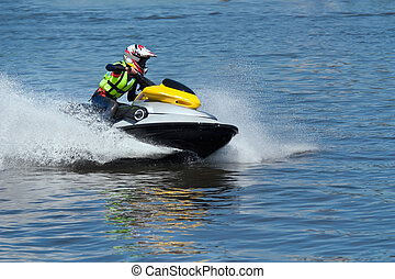 High-speed jetski - Woman riding high-speed jet ski