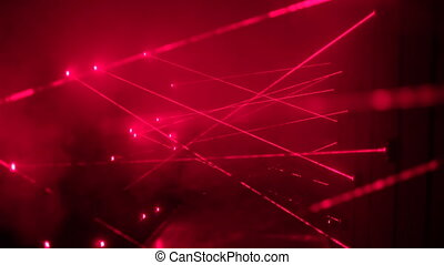 Thief trying to see security laser beams used for bank safety using the fog machine