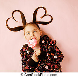 Heart pigtails valentine - Young girl licking Valentines...