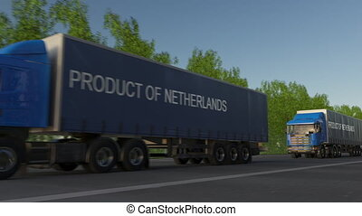 Moving freight semi trucks with PRODUCT OF NETHERLANDS caption on the trailer. Road cargo transportation. Seamless loop 4K clip