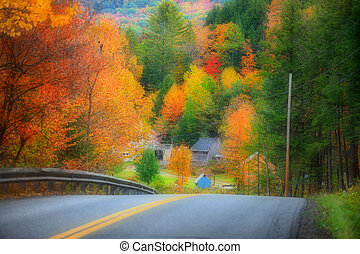 Scenic rural drive in Vermont with fall foliage
