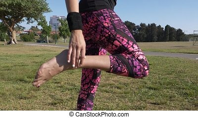 Woman doing leg stretch - Shot of Woman doing leg stretch