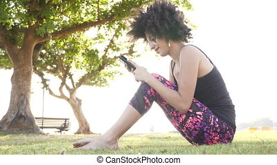 Woman with mobile phone at the park - Shot of Woman with...