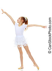 Girl gymnast waving his hands. - Cheerful little girl...