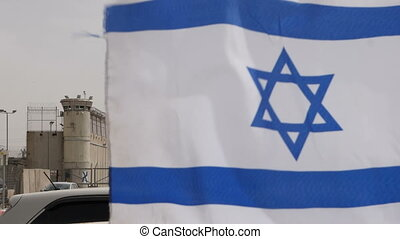Israeli flag near the border - Shot of Israeli flag near the...