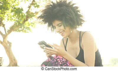 Smiling Young cool looking girl with mobile phone - Shot of...
