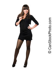 Young smiling brunette posing in black clothes Isolated on...