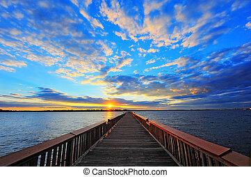 Pier into the Sunset - Fishing pier on the Chesapeake Bay,...