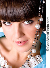 woman with pearl beads - closeup portrait of attractive...