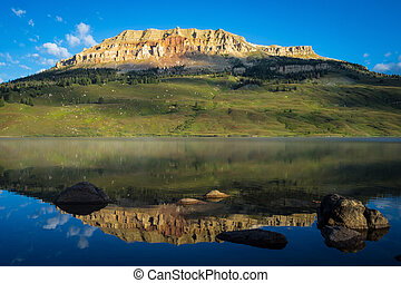 Sunrise on lake with Bear to Butte in the background, Montana
