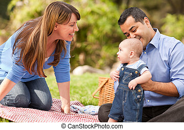 Happy Mixed Race Family Playing In