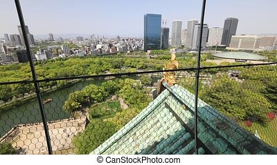 Osaka Castle and skyline - Aerial view time lapse from top...