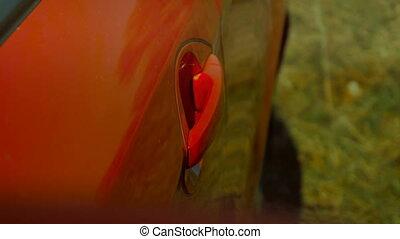girl opens the door in the red car