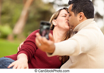 Attractive Mixed Race Couple Taking Self Portraits in the...