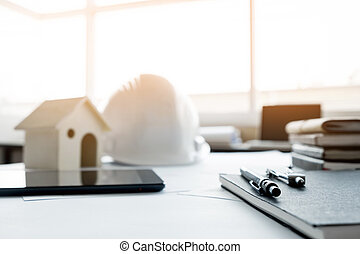Construction equipment. Repair work. Drawings for building Architectural project, blueprint rolls and divider compass on table. Engineering tools concept with copy space.