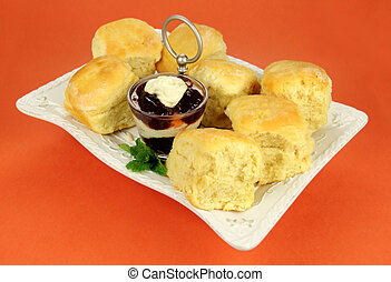Scone Tray - Fresh Baked scones with jam and cream on a tray...