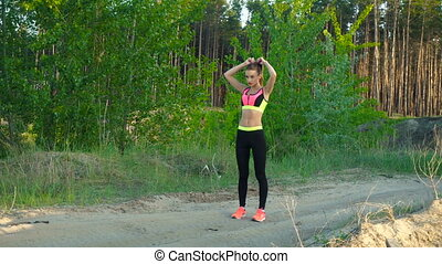 young beautiful girl in sportswear outdoors