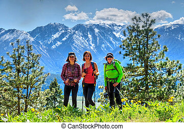 Group of friends hiking in mountains. - Cascade Mountains....