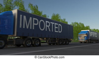 Speeding freight semi truck with IMPORTED caption on the trailer. Road cargo transportation. Seamless loop 4K clip