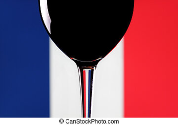 French wine. - A glass of red wine on a French flag...