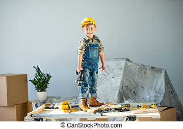 Little boy with tools