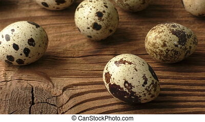 Quail eggs on a wooden board