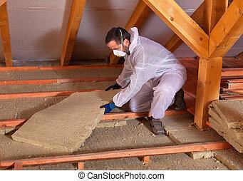Man laying thermal insulation - placing rockwool panels to...