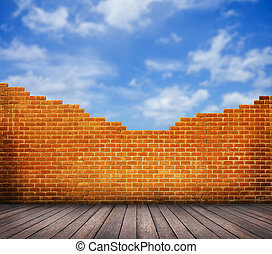 Wood floor with red brick wall and blue sky background