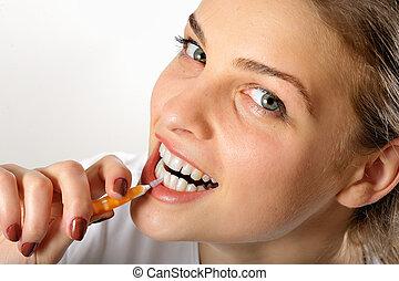 Girl using Interdental Brush for teeth  hygiene