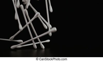 Slow mo. Cotton buds fall down on the table - Slow mo. Large...