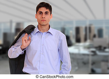 business man at the office - Handsome young business man at...