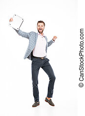 Happy young man standing isolated