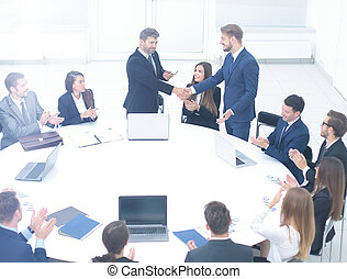 concept of business meetings,business partners shake hands to th