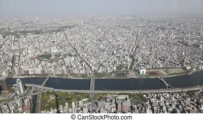 the Tokyo skyline - Aerial view time lapse of Tokyo city...