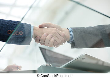 businessman shaking hands to seal a deal with his partner -...