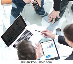 Group of business people busy discussing financial matter...