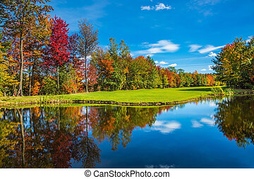 Shining sunny day in French Canada. Red, orange and yellow...