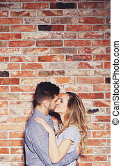 Woman and man kissing - Young woman and her man kissing on...
